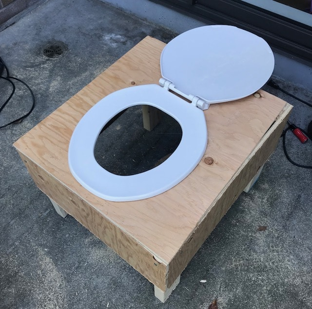 Attaching the seat to your composting toilet