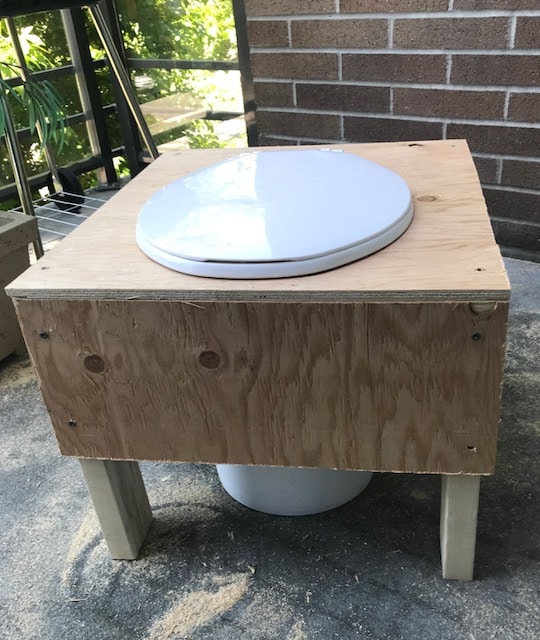 Front view of a composting toilet