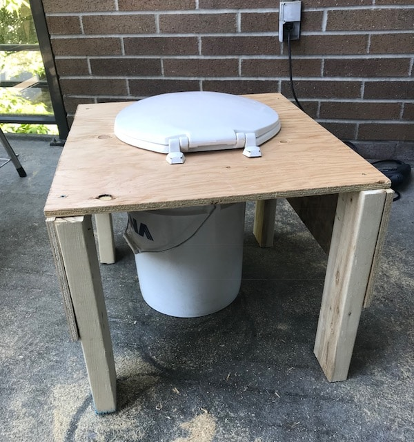 Back view of a composting toilet